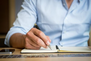 businessman writing restaurant business plan
