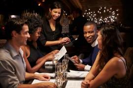Waitress Takes Order In Restaurant Using Digital Tablet