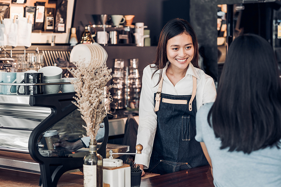 Asian Woman Barista Wear Jean Apron Holding Coffee Cup Served To